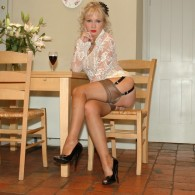 Fetish model Nylon Sue kitchen set in white lace see through blouse, knee high skirt, RHT stockings, and open toe heels…. she gets a little risky with the rolling pin. Nylon Sue...