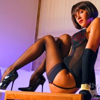 Lily Wow showing off her amazing slim legs, I just can't get enough of Lily. She's rocking some sexy black lingerie with gloves, nice high heel pumps, and a pair...