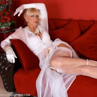 Sexy Amazing Astrid in white lingerie, sheer nightgown, garter belt, fully fashioned nylons, and a pair of sexy mary jane high heel pumps. She's pretty foxy for a mature lady...