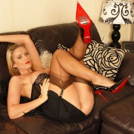 Here is another set from Vintage Flash of the sexy British blonde with big tits Lucy Zara rocking a vest and blouse combo plus a black mini skirt, garter belt,...