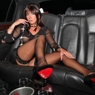 German vixen Stella Van Gent loves her femdom and kinky fetishes and this photo set is from her official site called Red Optics. She has some a sheer top with...