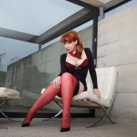Busty British redhead MILF rocking some fully fashioned stocking in this double set! Black and Red stockings showing off her legs and of course her nice lush tits! Show her...
