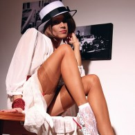 Lily Wow looking nice and classy in this set rocking a white dress and hat with a pair of stockings on those long slender sexy legs of hers. Like What...