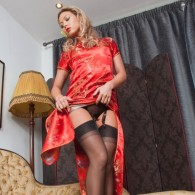 Sexy Natalia Forrest rocking a nice silk Chinese dress with a pair of black fully fashioned stockings and heels in this set from Vintage Flash. Vintage Flash Has Amazing Nylon...