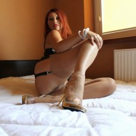 Redhead Vixen Nylons in some nice stockings showing off her nice legs body rocking some of her lingerie collection in this triple set. Checkout her site guys, she knows the...